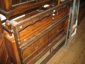 Oak open plate rack with a moulded cornice above a