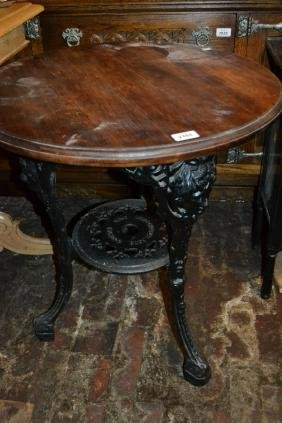 Early 20th Century circular cast iron pub table with a