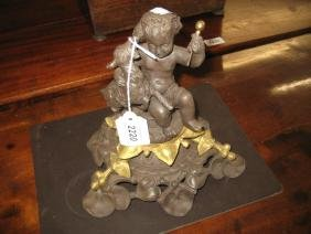 19th Century cast iron and gilt metal mounted figure of