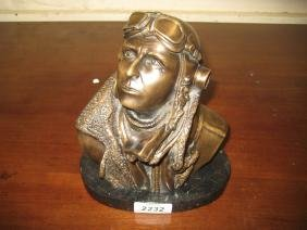 Modern bronze bust of a 1940's pilot on oval marble
