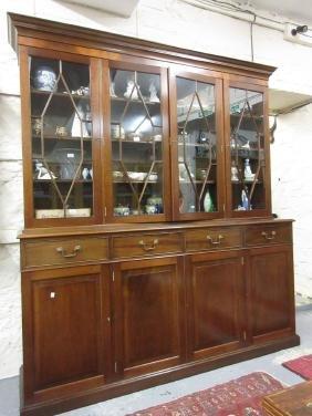 Good quality reproduction mahogany four door bookcase
