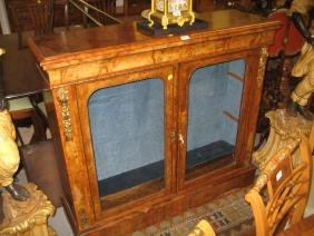 Victorian figured walnut pier cabinet having moulded