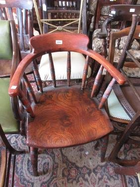 20th Century bow back armchair on turned supports,