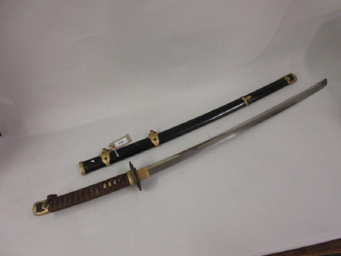 Japanese katana, the 32.25in blade (including tang),