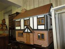 Large modern dolls house with beamed and brick facade