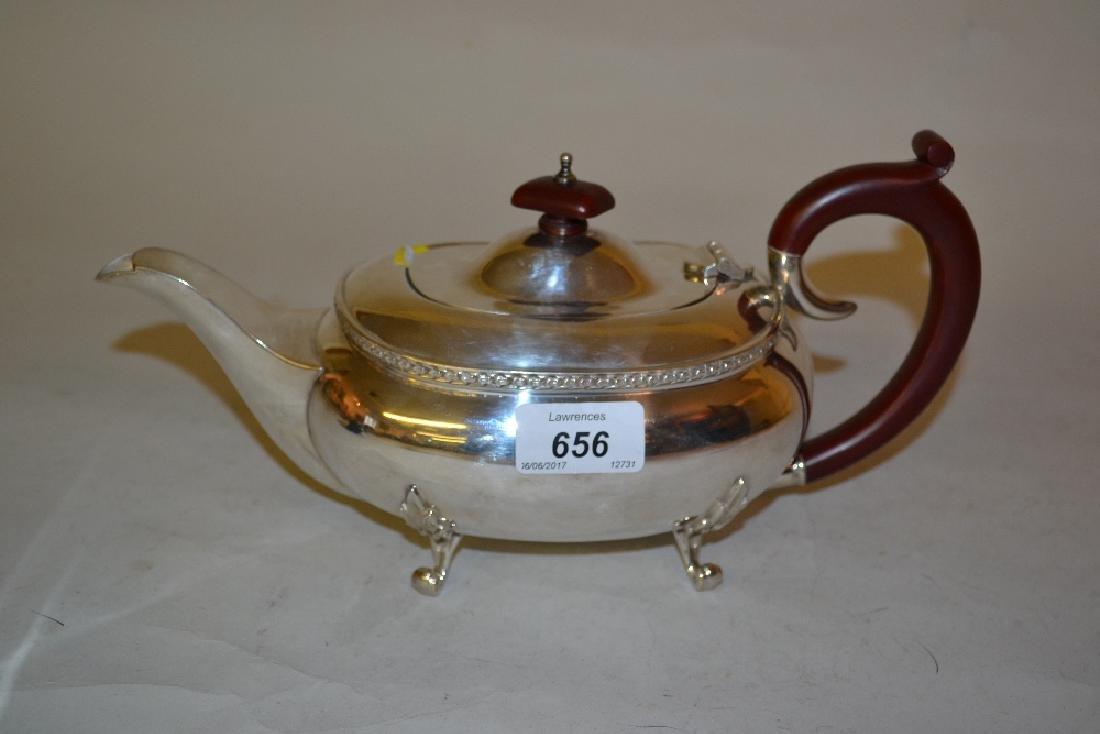 Modern Birmingham silver teapot of oval squat design on