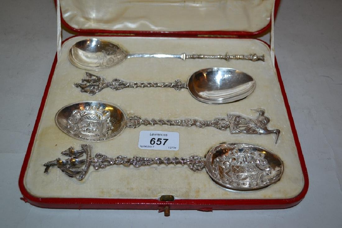 Cased group of four Continental silver serving spoons