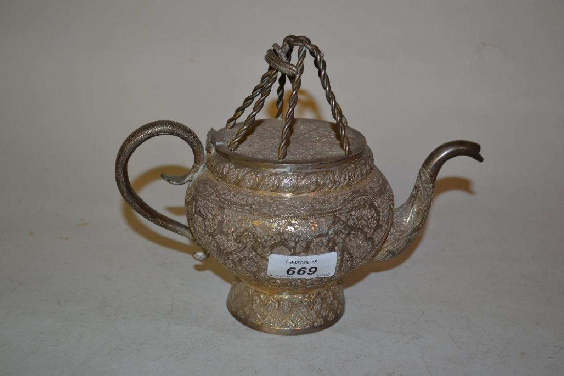 Middle Eastern white metal teapot with engraved floral