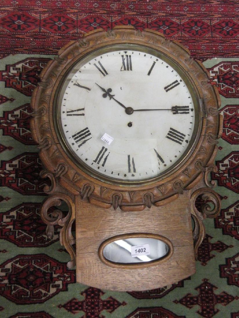 19th Century carved oak drop-dial wall clock having