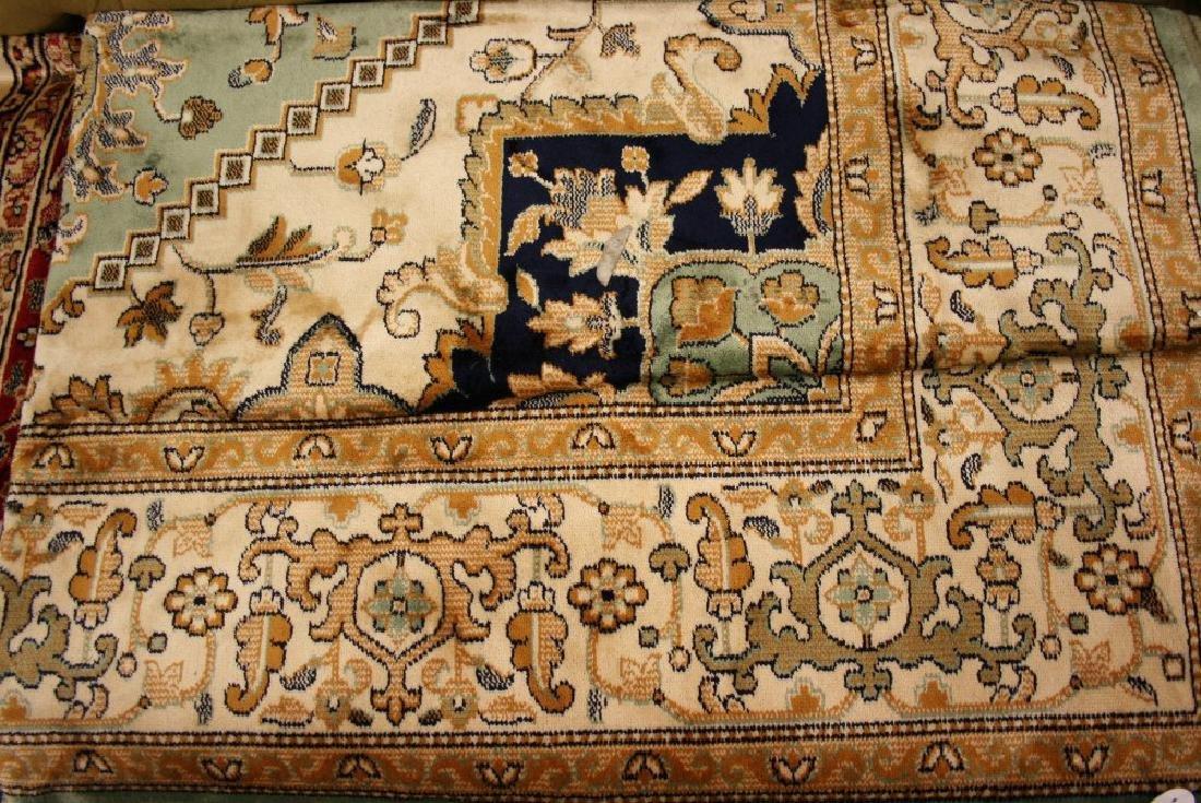 Heriz style machine woven green ground carpet, 2.30 x