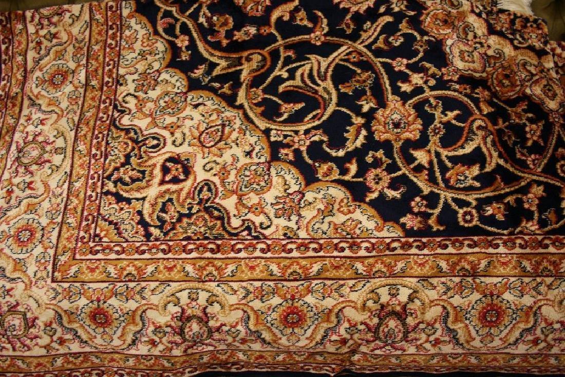 Kashan style machine woven blue ground carpet, 1.90 x