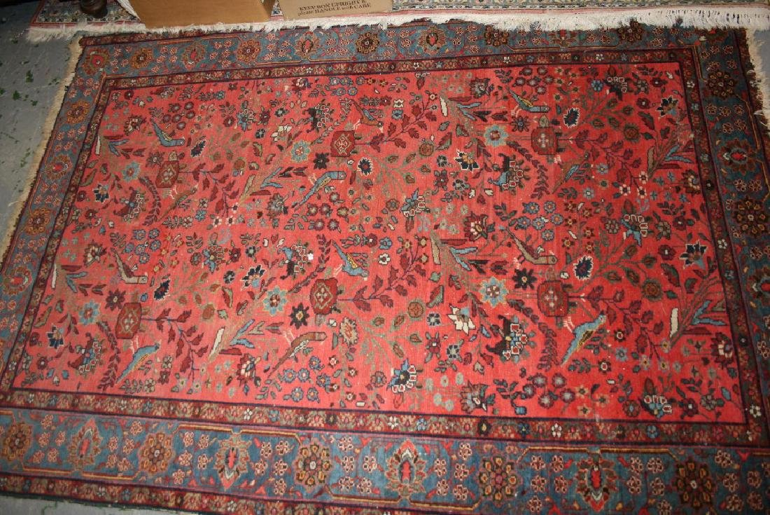 Near matching Saruq rug with all-over stylised floral