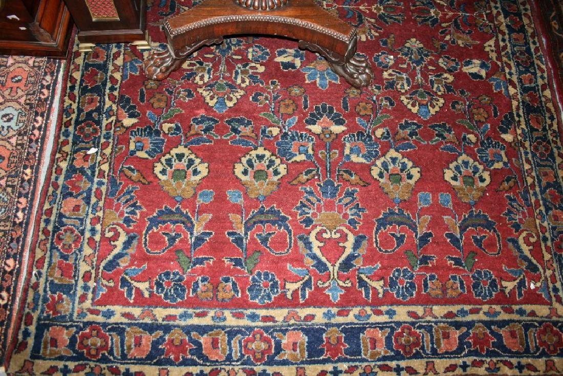 Saruq rug with an all-over stylised floral design on a