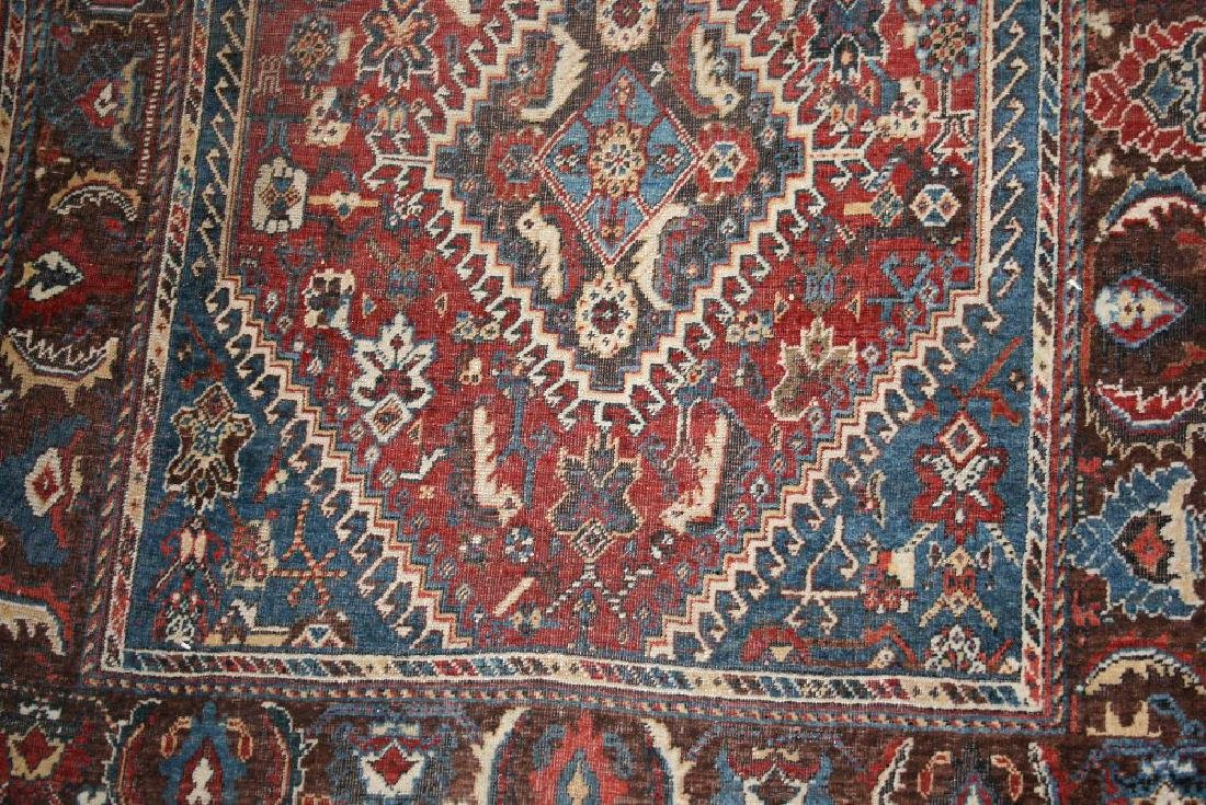 Shiraz rug with a triple hooked medallion and all-over