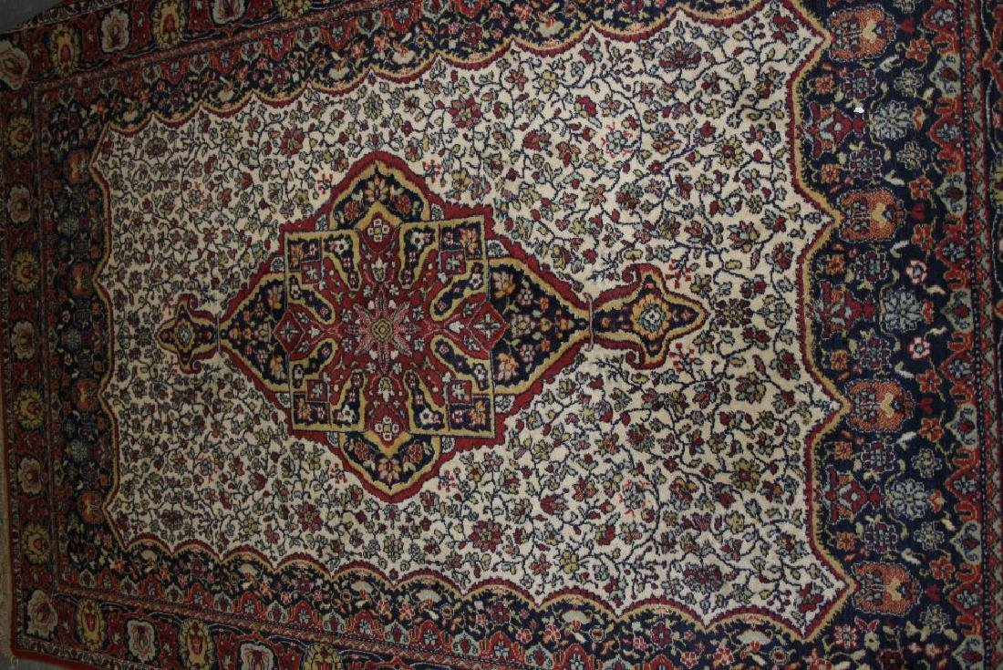 20th Century machine made Persian style carpet together