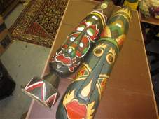 Pair of large African carved wood and painted wall