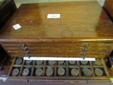 Pine coin collectors cabinet containing a collection