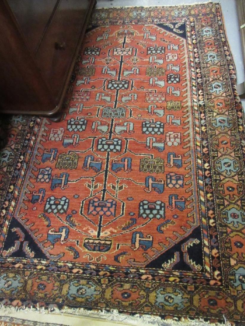 Kurdish rug with stylised tree of life design on a