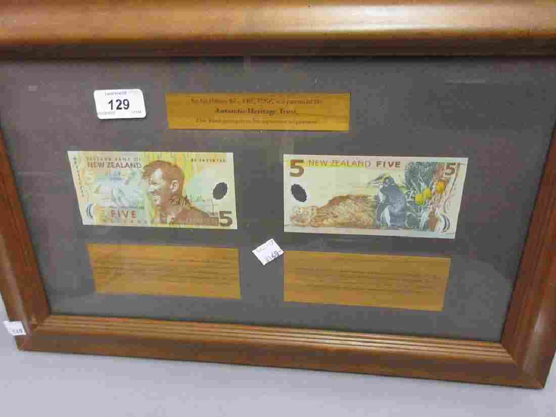 Two New Zealand five dollar bank notes, one signed by