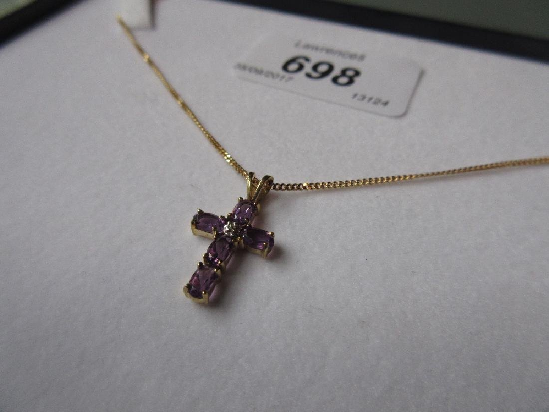 9ct Gold amethyst and diamond set pendant cross on a