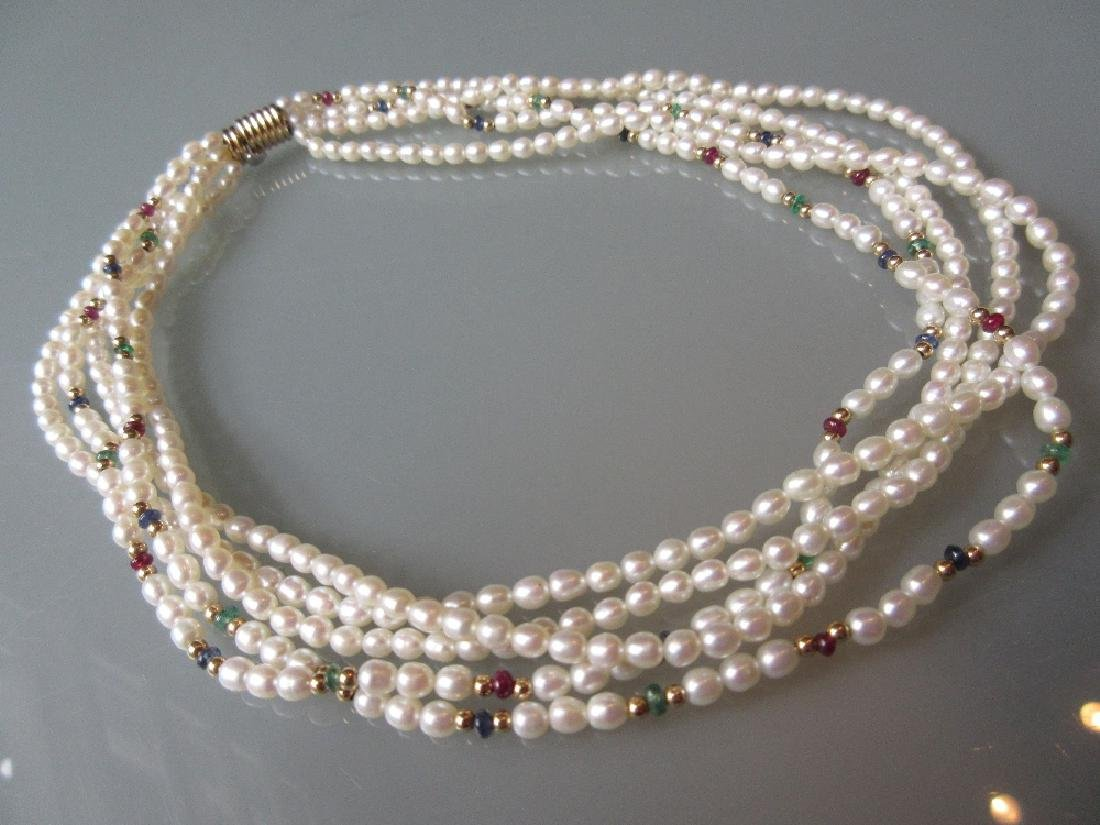 Five strand cultured pearl necklace interspaced with