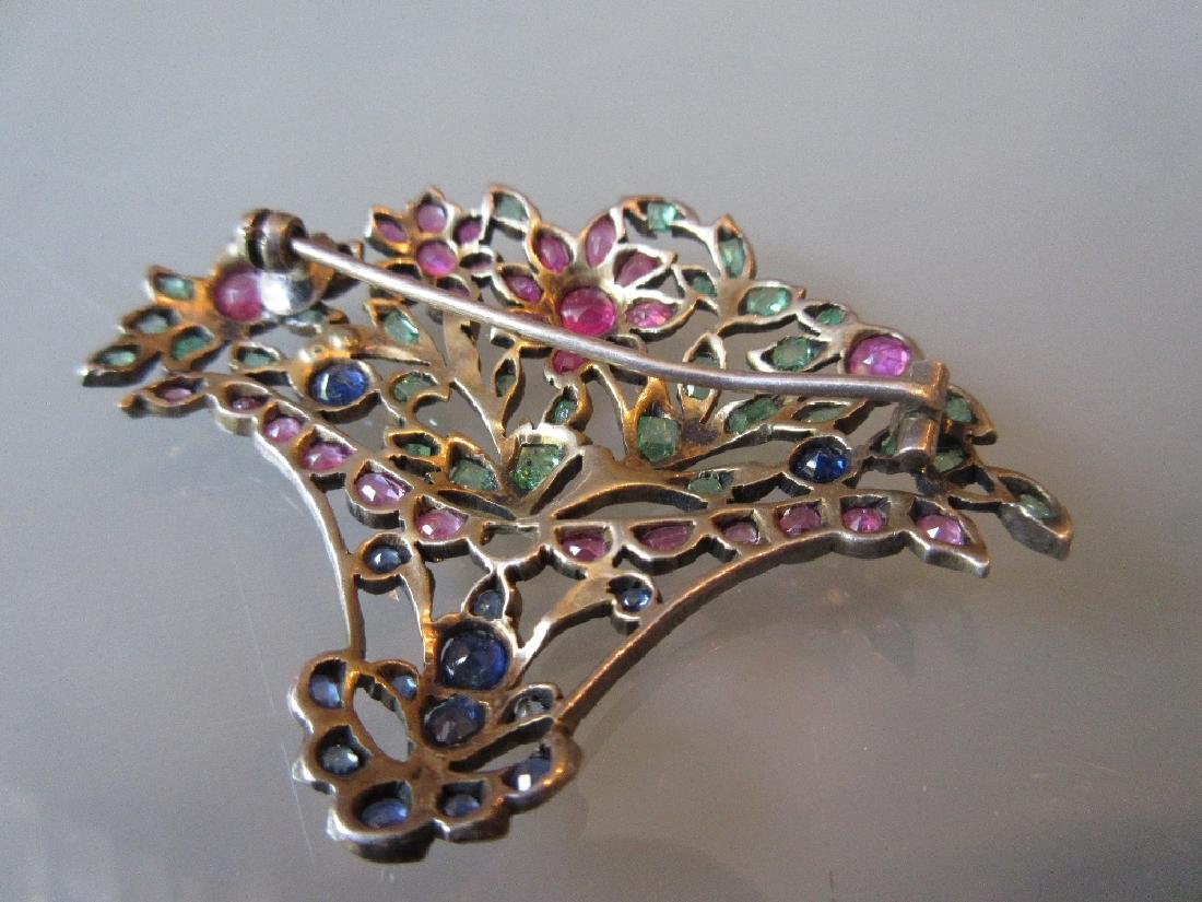 Giardenetto brooch set rubies, emeralds and sapphires
