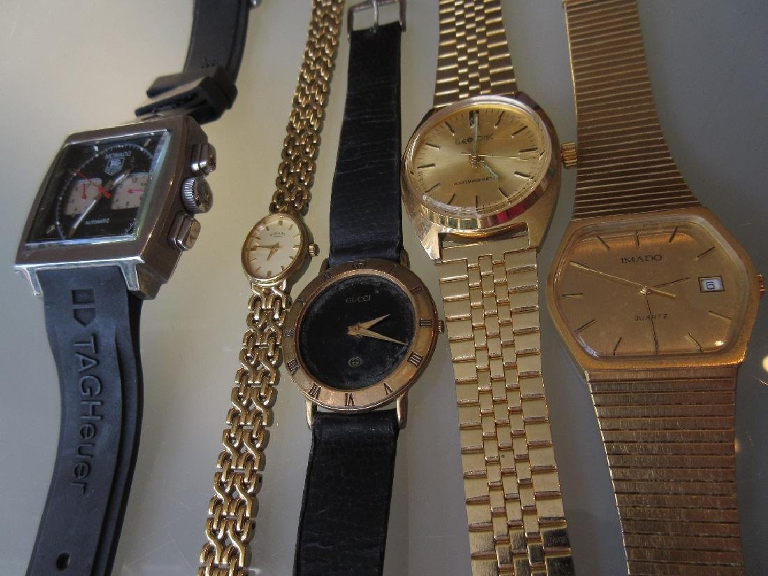 Four various gentlemens wristwatches and a ladies