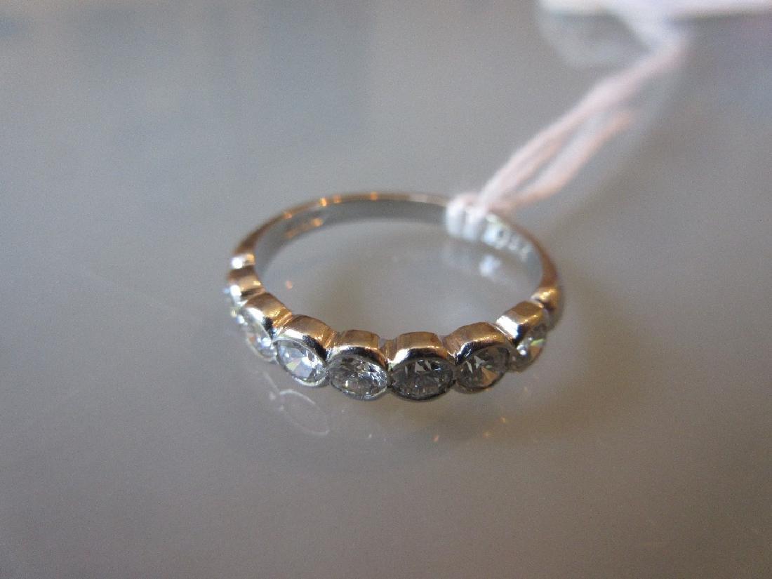 Platinum seven stone diamond half hoop ring
