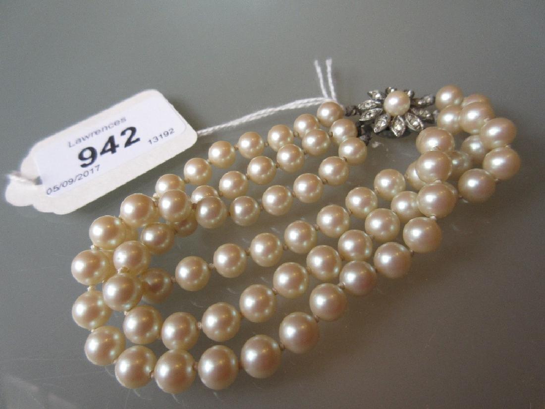 Triple row uniform cultured pearl bracelet with a