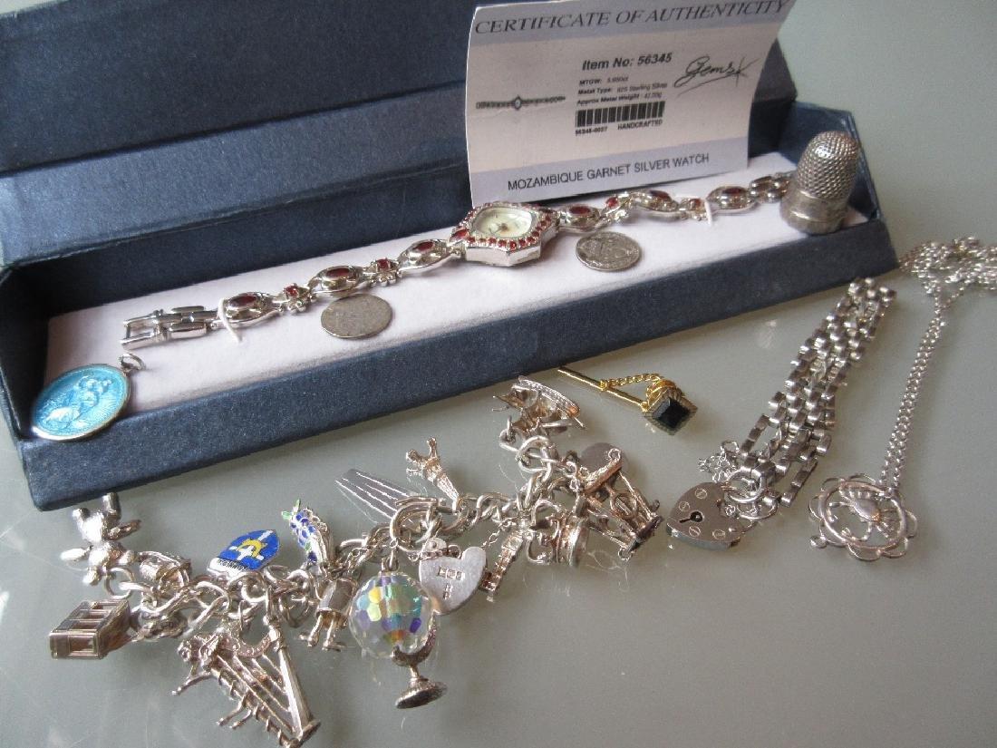 Ladies silver garnet set wristwatch together with a