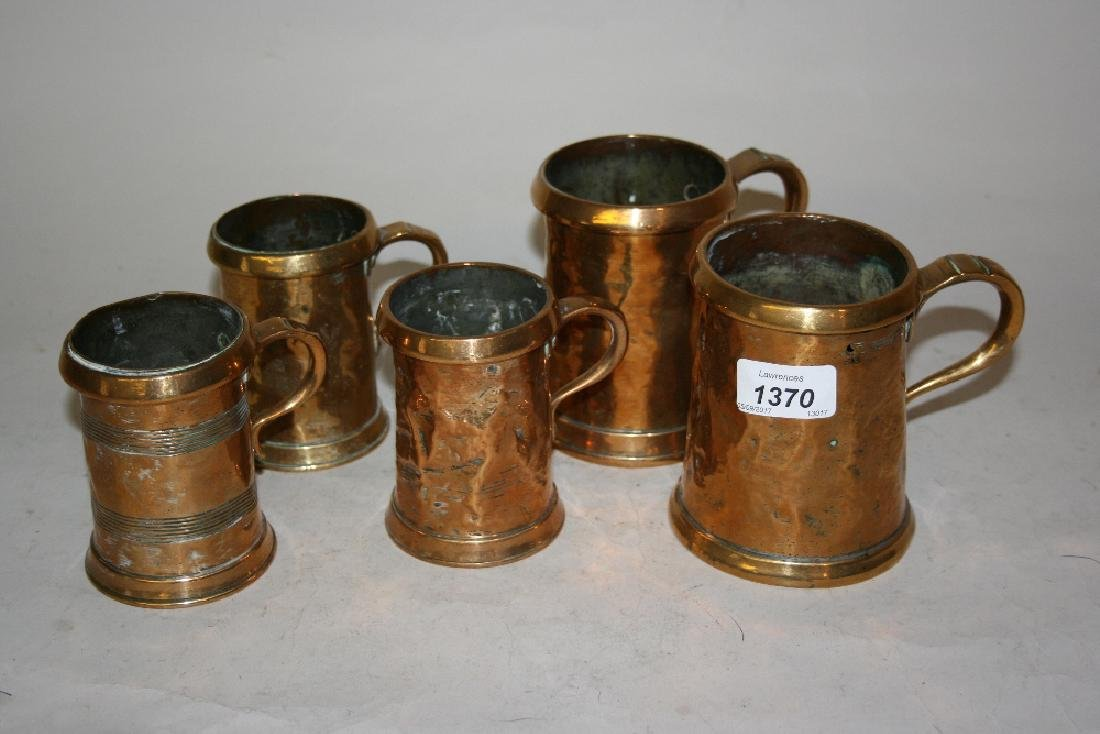Five various Georgian brass mounted copper mugs