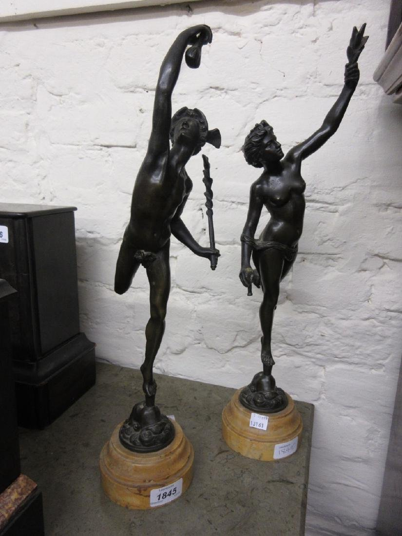 Pair of 19th Century brown patinated bronze figures of