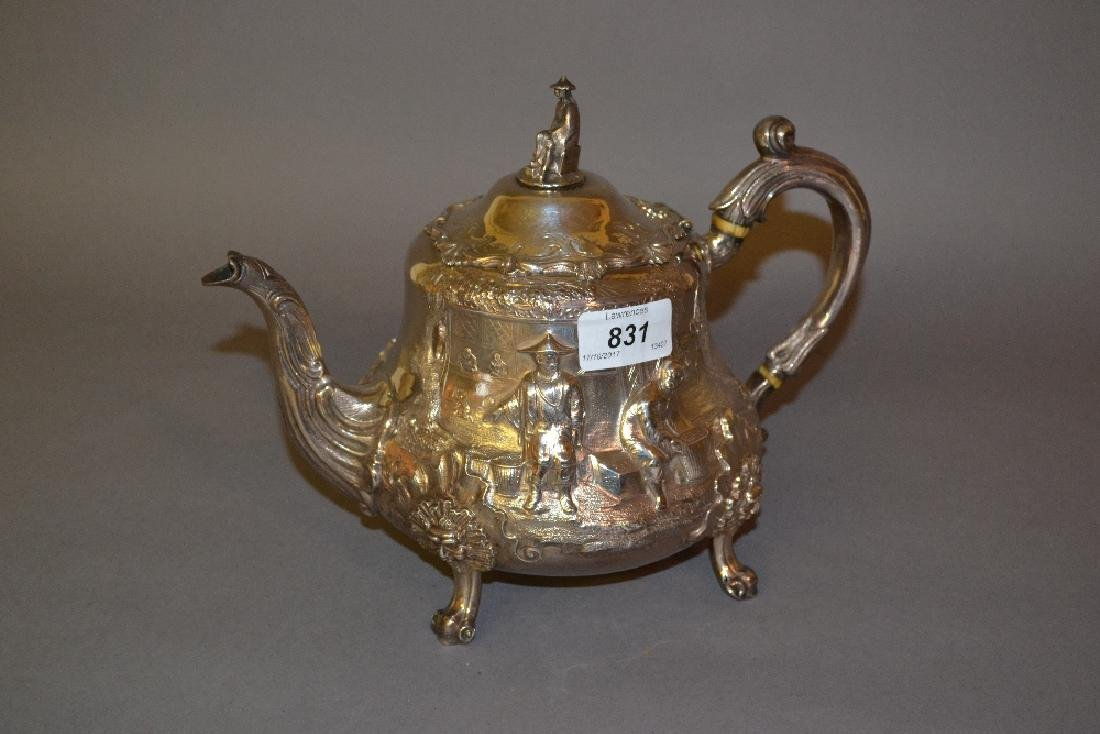 Victorian silver teapot decorated in high relief with a