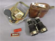 Pair of leather cased binoculars marked Grand National,