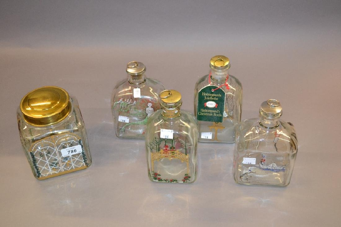 Four Holmegaard Christmas decanters and a biscuit jar