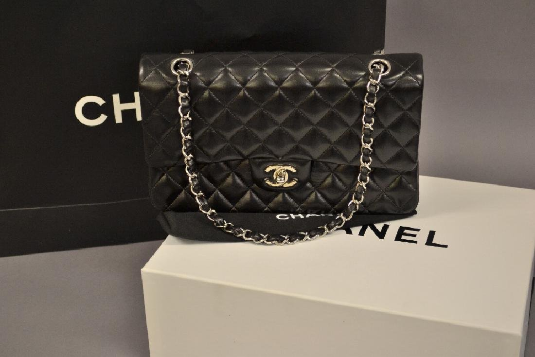 Ladies Chanel Uni black quilted handbag with original