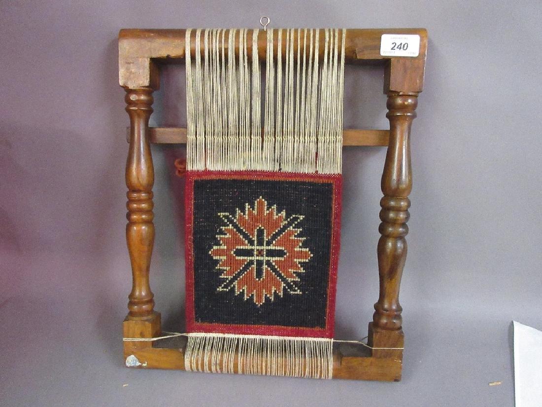 Small hardwood loom with salesman's small carpet sample