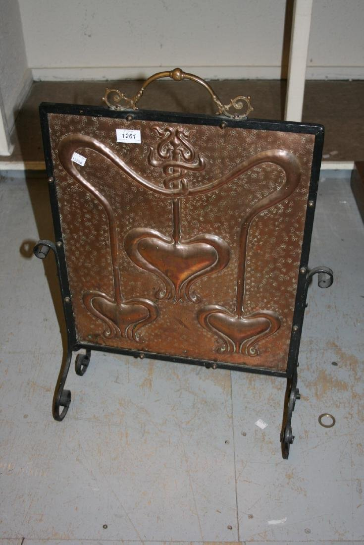 Art Nouveau embossed copper and wrought iron firescreen