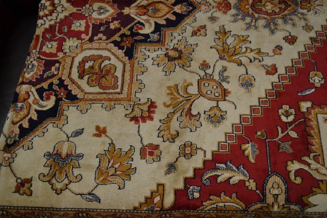 Beige ground Heriz pattern carpet, 2.30m x 1.60m