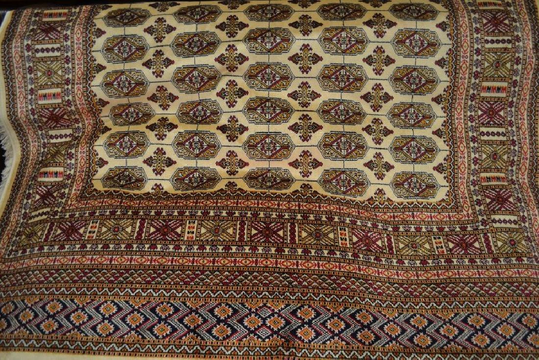 Beige ground Bokhara pattern machine rug, 1.9m x 1.4m