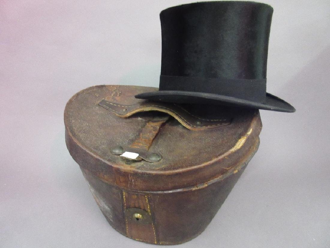 19th Century brown leather hat box containing a top hat