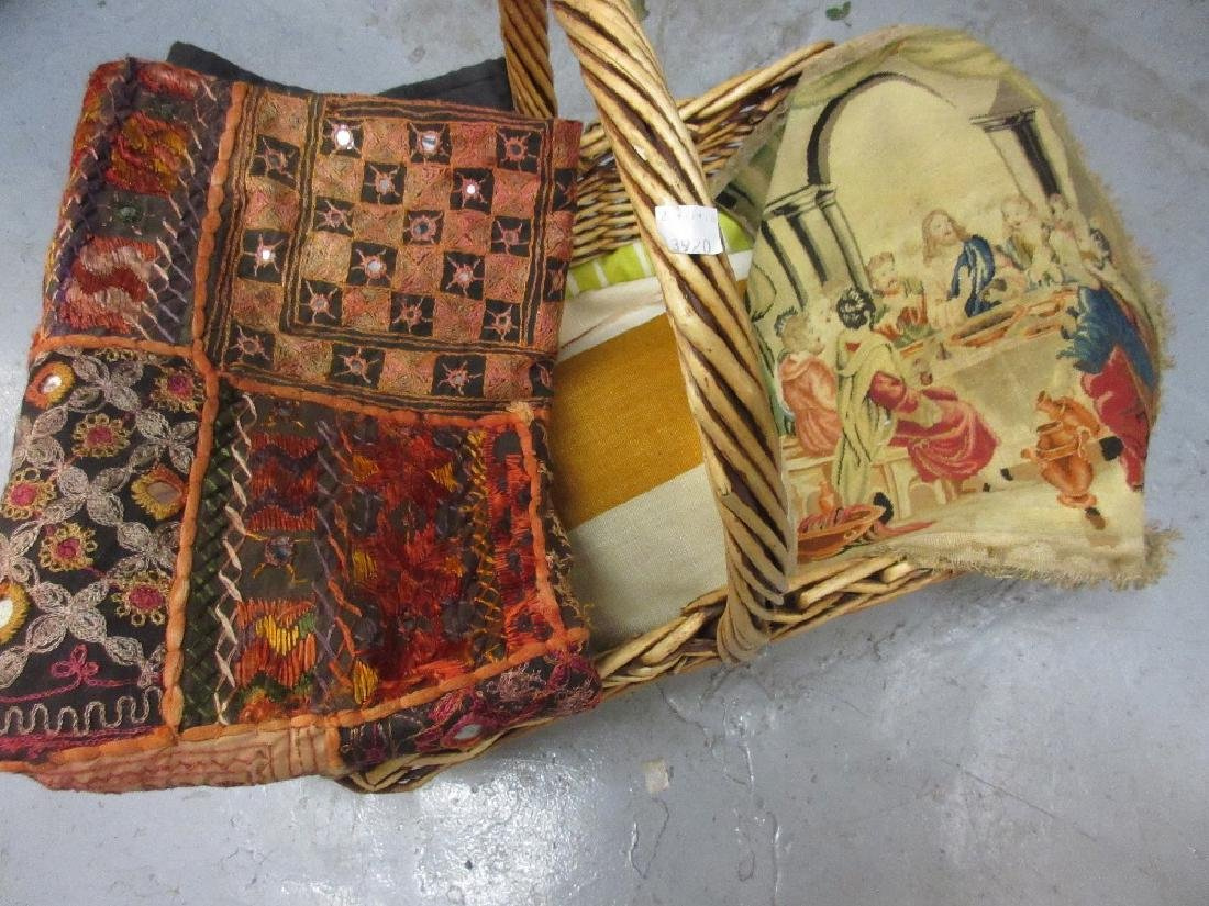 Basket containing a quantity of various textiles