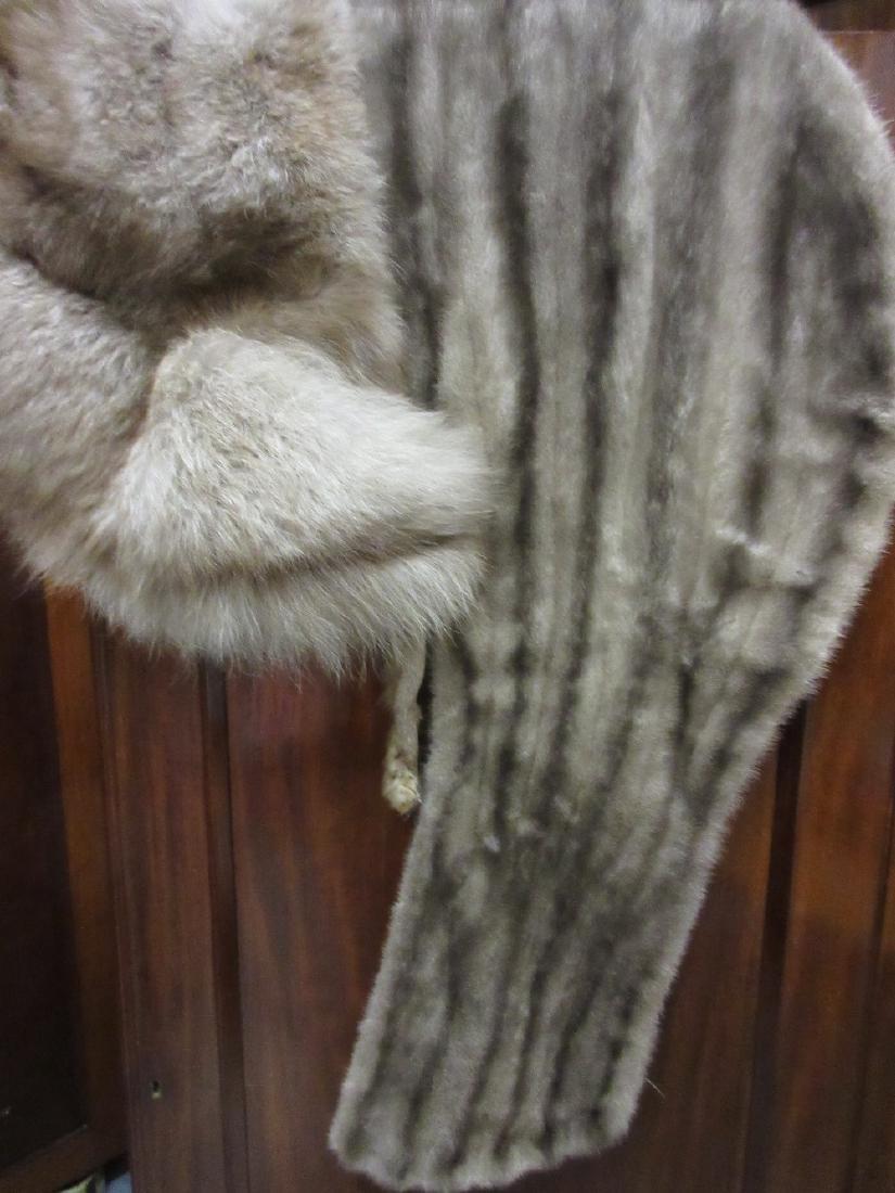 Two ladies fur stoles