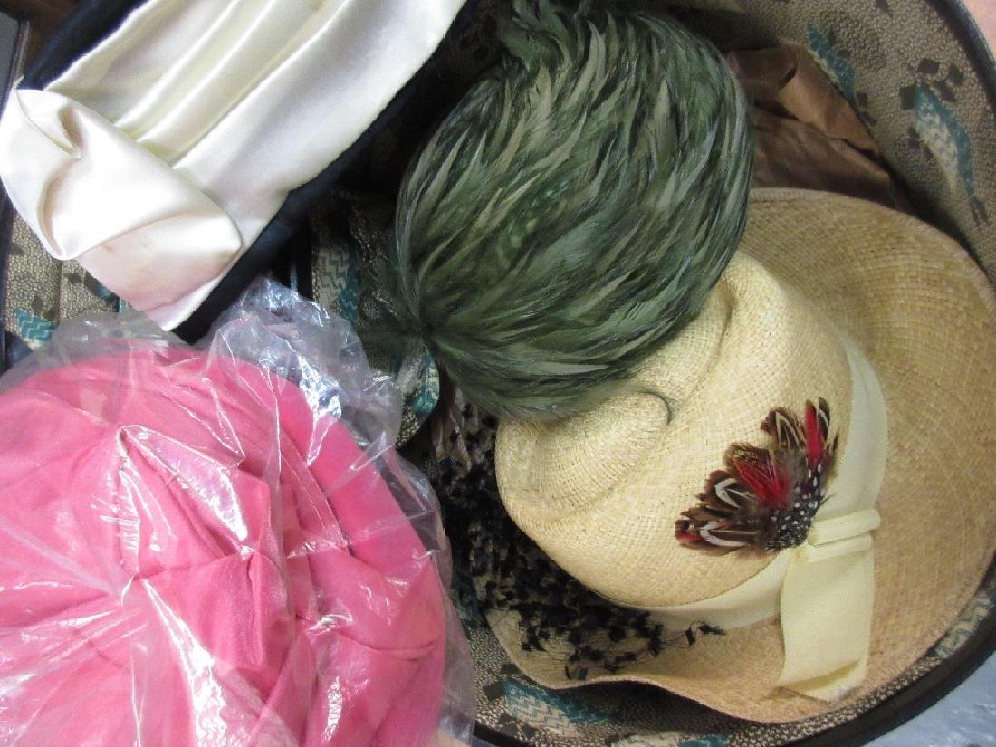 Three various hat boxes and various ladies hats