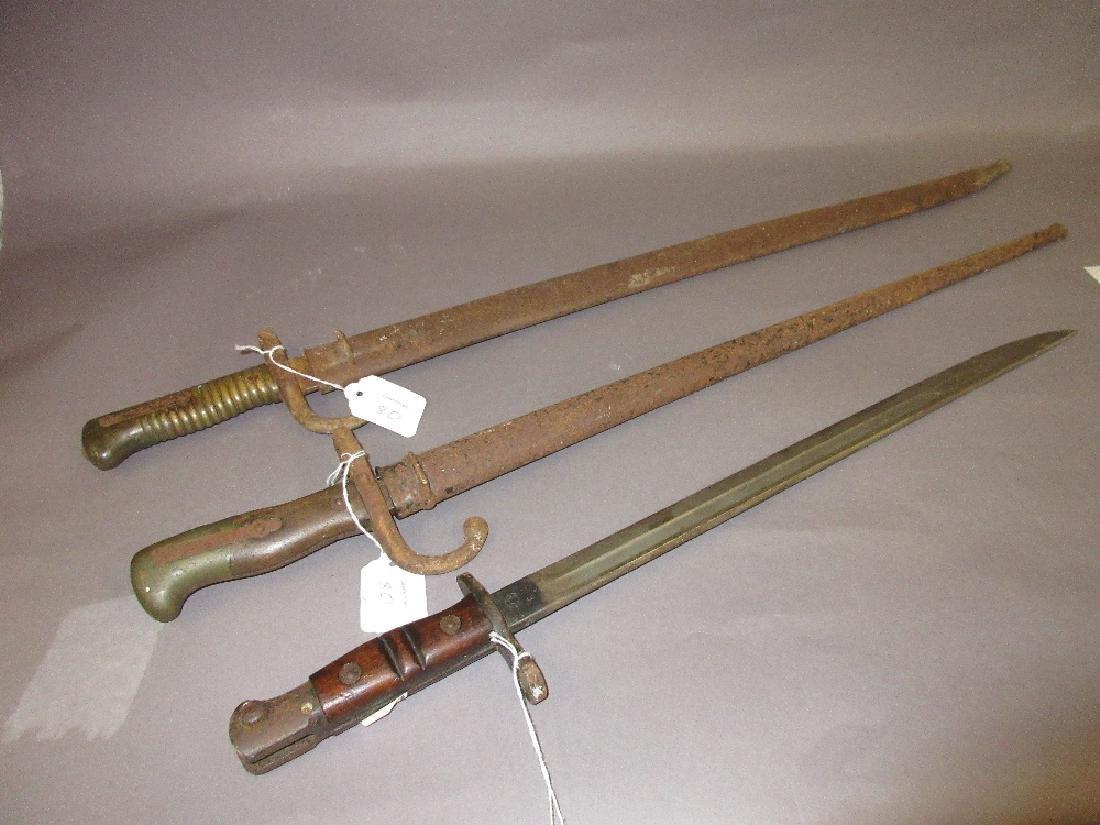Three various World War I bayonets