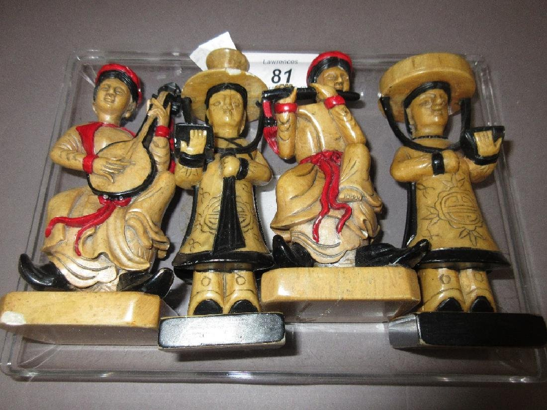 Group of four Eastern soapstone musician figures