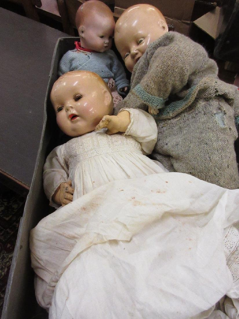Bisque headed doll (at fault) together with two