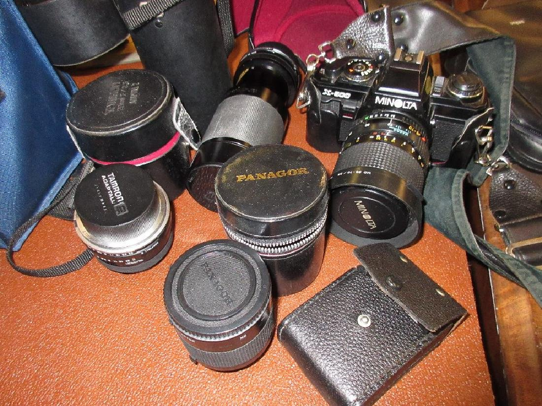 Minolta SLR X500 camera with various lenses including a