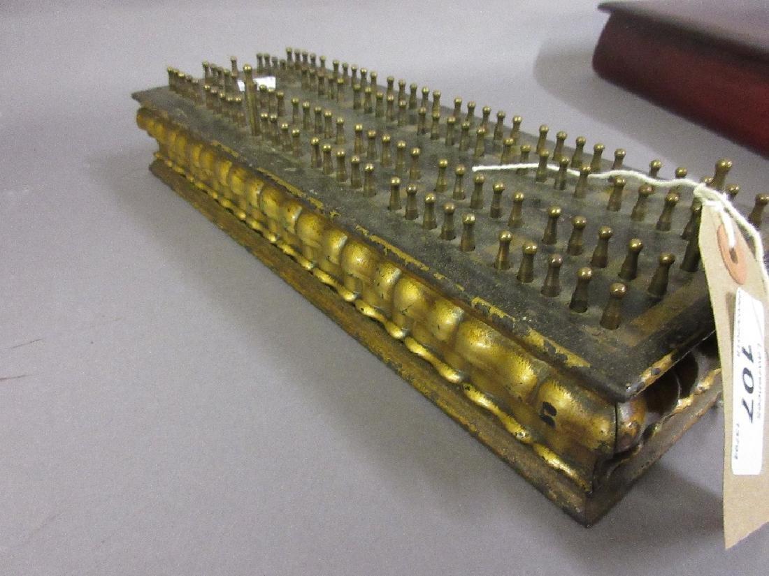 Early American rectangular patinated metal calculator