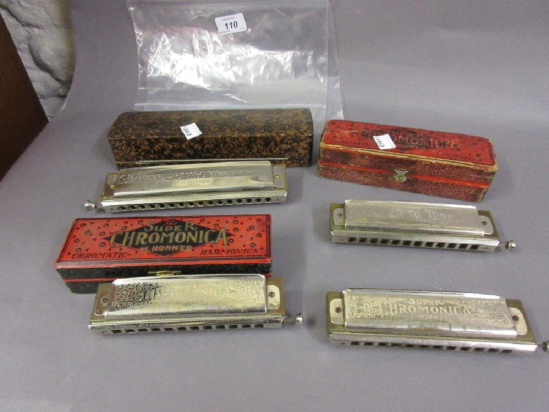 Four various mouth harmonicas